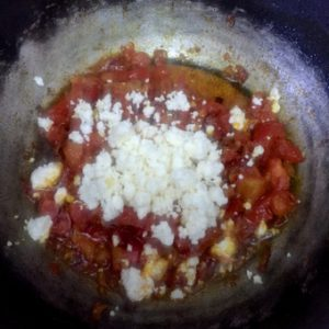 Curd or crumbled paneer or cottage cheese added to the gravy