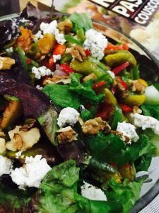 Salad of roasted figs, greens, walnuts, tomatoes and goats cheese