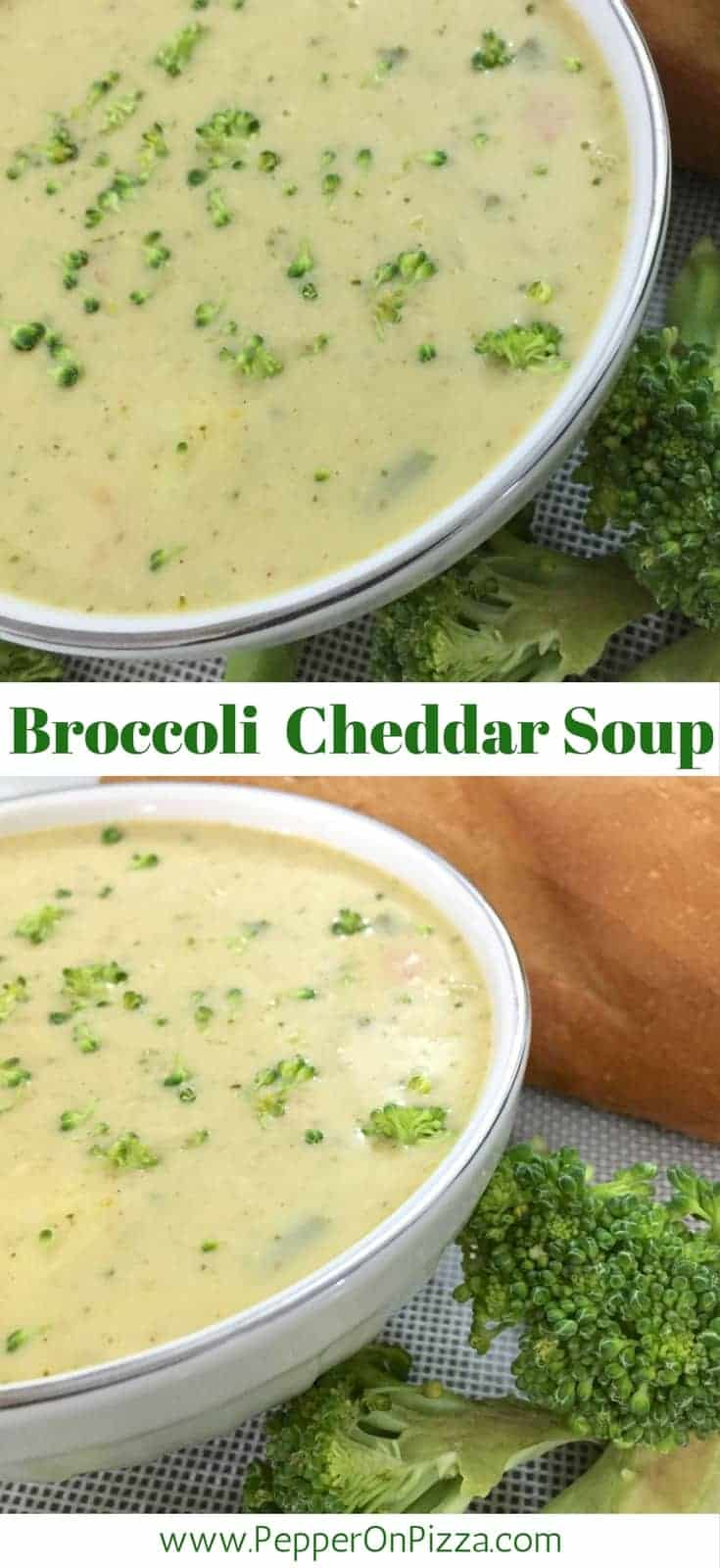 Thick pale Yellow broccoli cheddar soup flecked with green bits of broccoli and herbs in a white bowl, broccoli florets at the side and a baguette seen in the background