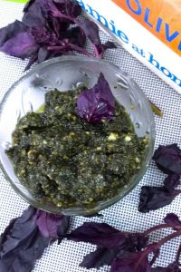 Easy and quick Purple Basil Pesto with Pine nuts and Parmesan following Jamie Olivers recipe. Green basil may be used instead of purple. Delicious!