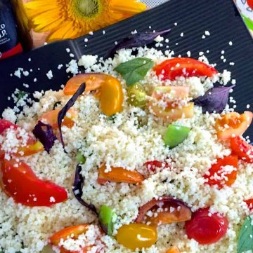 Roasted Tomato Couscous Salad with tomatoes of many colours and sizes, fresh basil, oregano, balsamic vinegar and lemon juice for a healthy refreshing salad