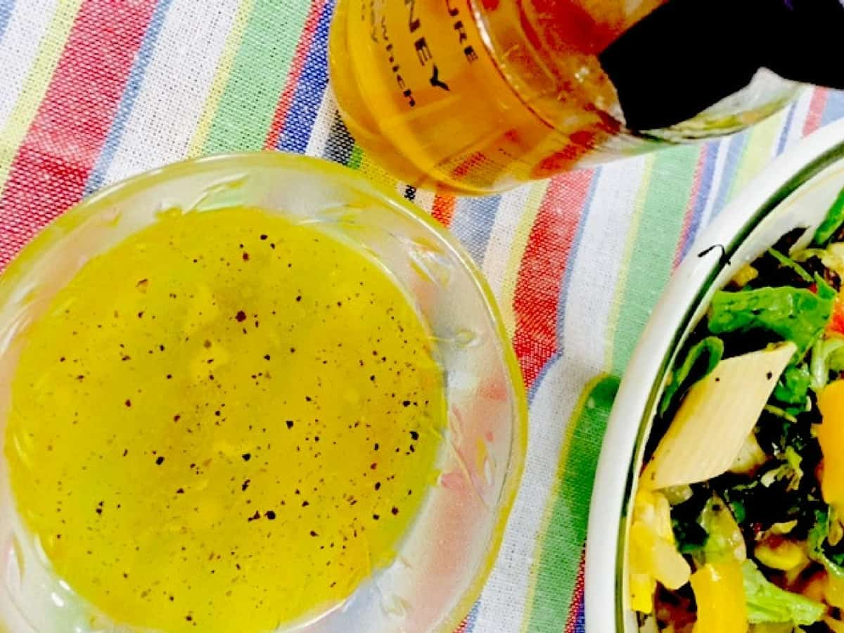 A tangy Honey Lemon Salad Dressing with the lingering taste of sweet natural Kumaon honey, this healthy dressing goes well with a green leafy salad.