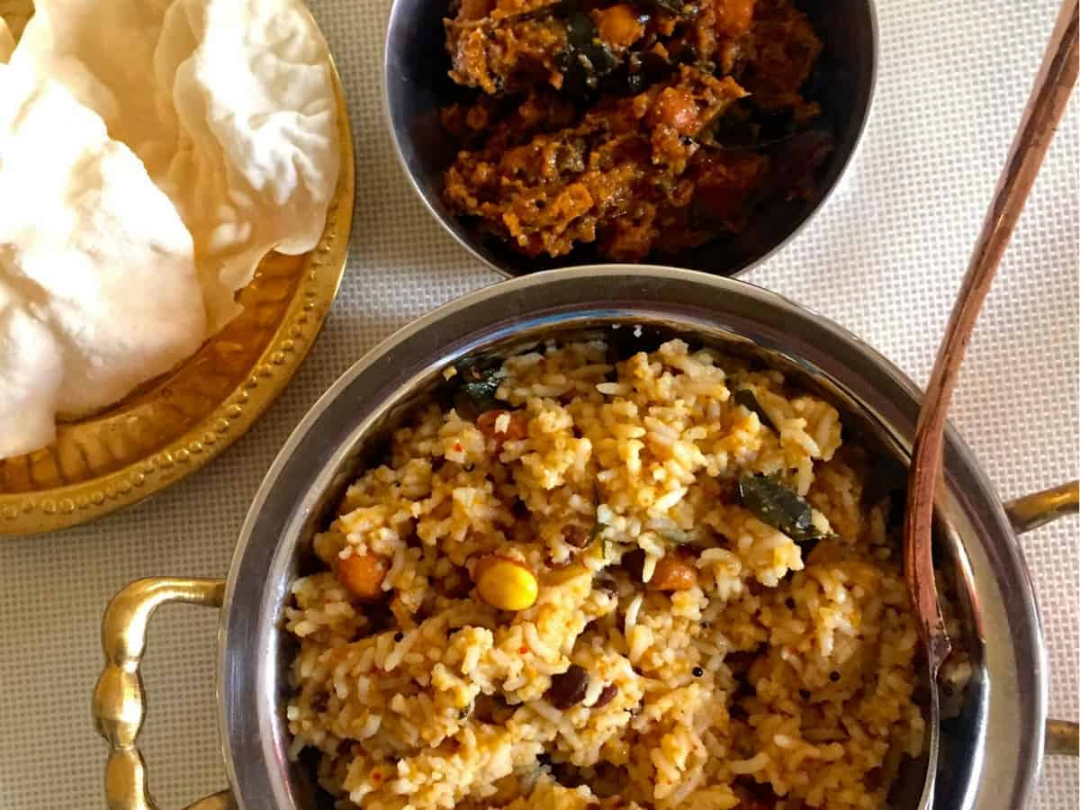 Pulikachal A South Indian paste of dry red chillies, spices, lentils and tamarind cooked in sesame oil and mixed with rice to make Puliyodharai.