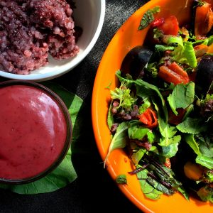 Garnish the Black Rice salad with almonds and raisins