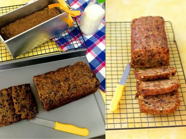 Rich Brown Christmas Fruit cake in a rectangular aluminium pan with a yellow ribbon on top. Slices of cake on a cooling rack with a yellow knife