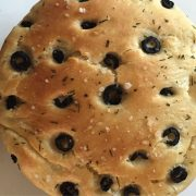 Olive studded focaccia garnsihed with salt and herbs