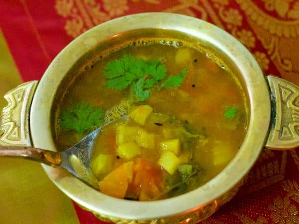 Festive Pineapple Rasam a tangy South Indian Pineapple Lentil Soup served with rice, papad and sautéed vegetable curry. Popular at Tamilian wedding lunches