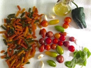 Tomato of different colours and shapes for making burst cherry tomato sauce for pasta