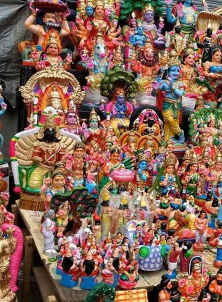 Colourful paper mache and clay dolls of Hindu Gods and other decorative items for Navaratri Golu in Chennai, India