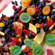 A colourful array of dry fruits read to be cut to soak fruits for Christmas cake