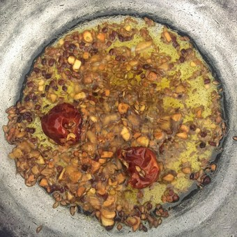 Heat oil and add cumin seeds, saute and add dry red chillies
