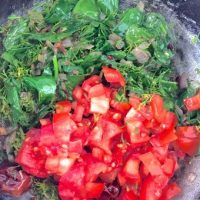 Add tomatoes and greens