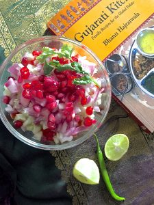 Kachumber Salad Mixed salad of fresh vegetables with lemon juice and chilli and garnished with pomegranates