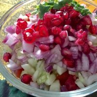 Toss the veggies together with lemon juice and salt and garnish with pomegranates