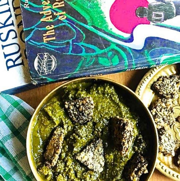 Split Urad dal vadi in spinach gravy, Sepu vadi, a spiced spinach and dill gravy with fried black gram lentil fritters, is a traditional curry from Himachal Pradesh in Northern India