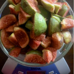 Sliced green fresh figs being weighed for homemade fig jam