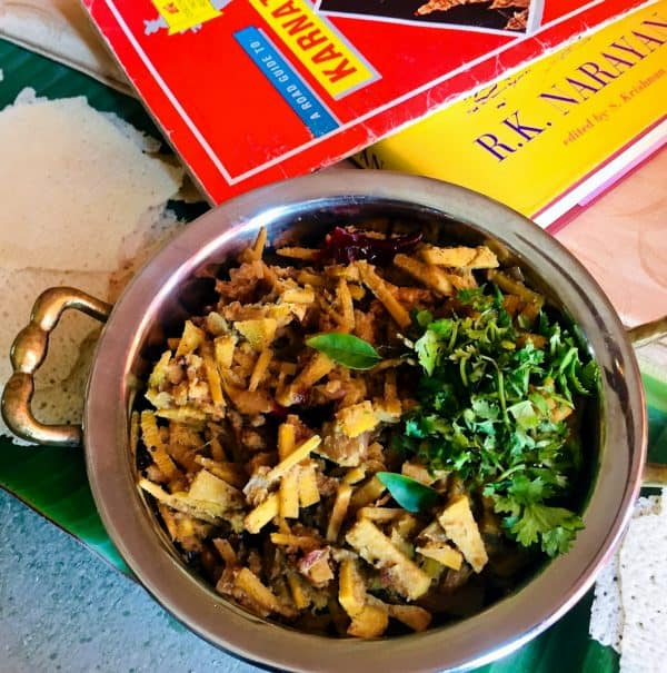 Bamboo shoot curry garnished with coriander leaves and a guide to Karnataka and a book by Mysore based author R K Narayanan alongside