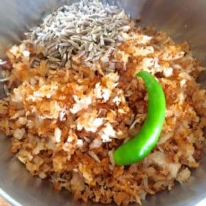 Roasted coconut, cumin and chilli to be ground into a paste