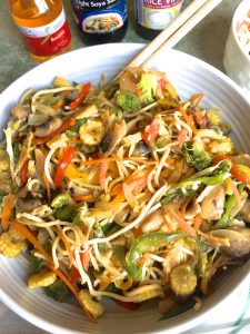 Easy to make stir fried vegetable noodles in a large bowl with chopsticks on the ready
