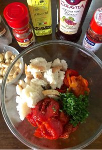 Ingredients ready for making Spanish Romesco Sauce -Roasted peppers, Tomatoes, bread, almonds, vinegar, chilli pepper flakes, smoked paprika, Olive oil, garlic, Parsley