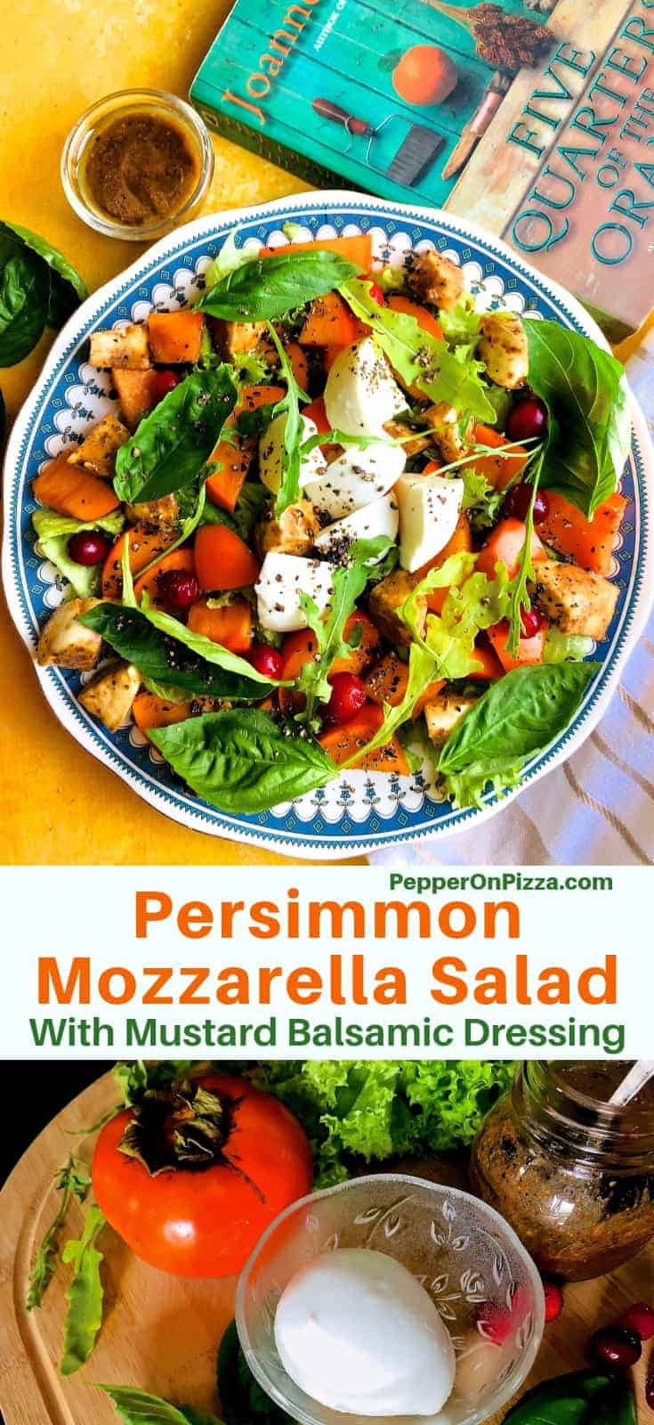 A plate edged in blue heaped with orange, green and white Persimmon Mozzarella Salad with a green and orange book on one side and a brown striped napkin below