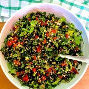 A bowl of levantine tabbouleh, the parsley bulgar tomato salad, on a green checked napkin