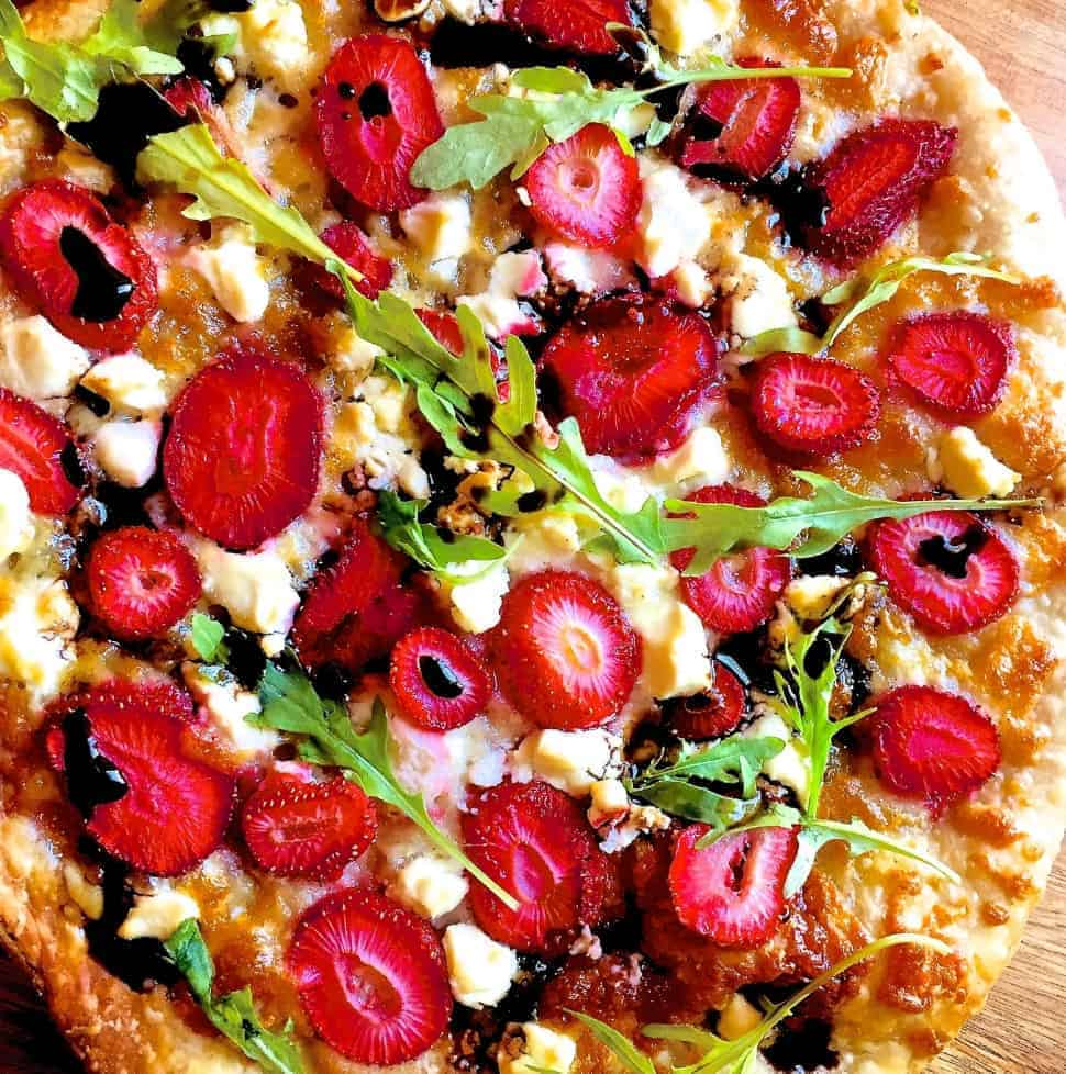 Strawberry Pizza with Goat Cheese , Mozzarella and Balsamic Reduction as well as Basil or Arugula/ Rocket leaves