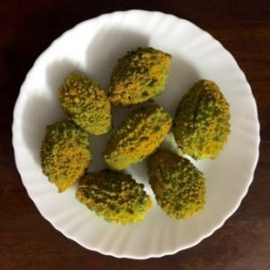 Process shot: Small bitter gourd/ karela/ pahakkai marinated with turmeric powder and salt