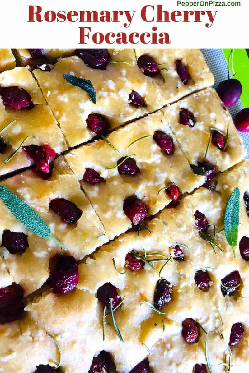 Rosemary cherry focaccia with sea salt scattered across, sliced into squares. Garnished with green sage leaves https://www.PepperOnPizza.com