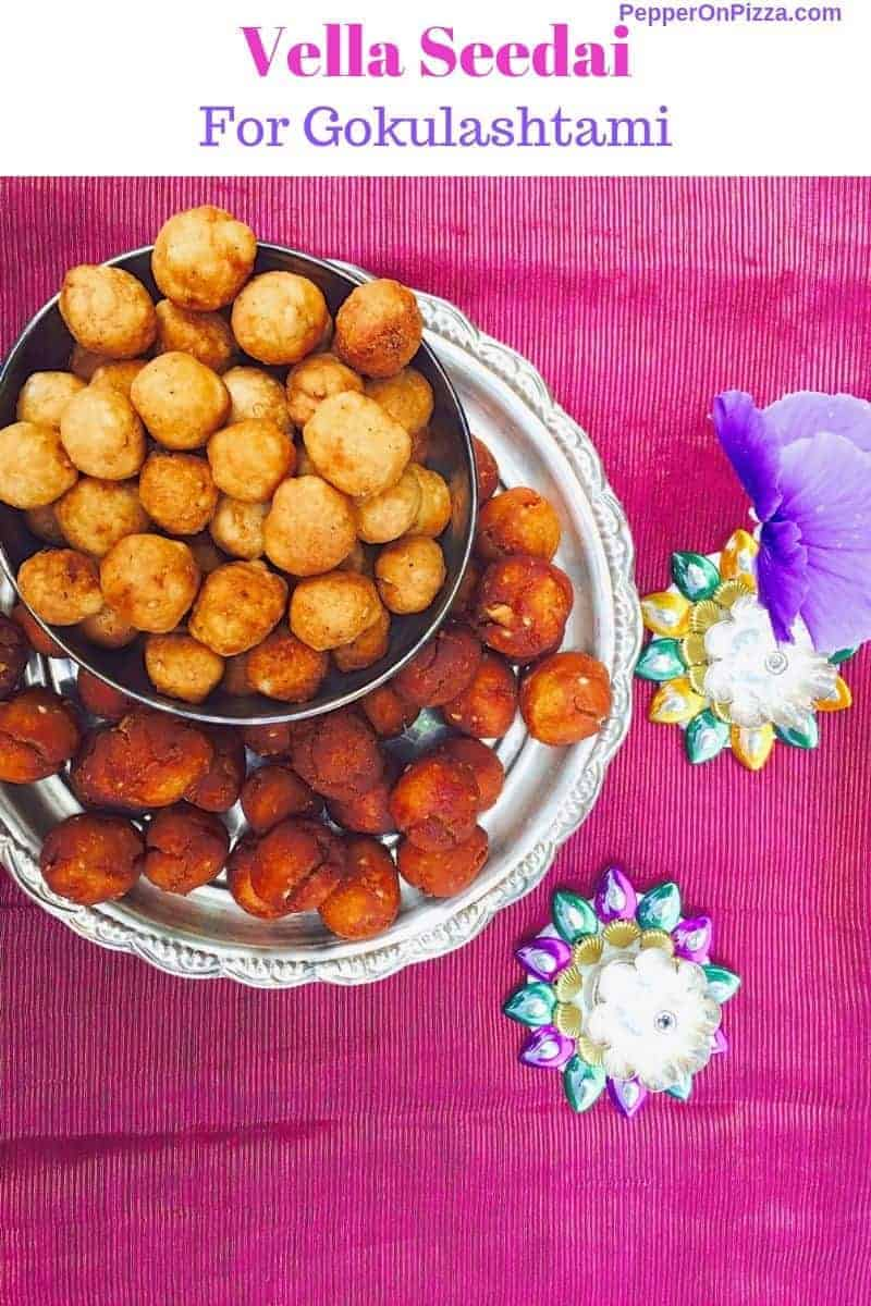 A plate of vella seedai from store bought flour and jaggery, with a bowl of lighter coloured uppu seedai above, on a dark pink silk fabric. Tiny colured sliver lamps and a purple flower to the right https://www.PepperOnPizza.com
