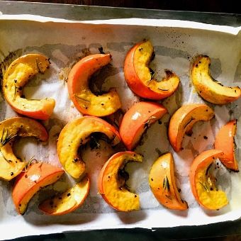 Process Shot 2: Place the marinated pumpkin slices on a greased parchment sheet lined baking sheet, and bake at 220 C for 20 minutes