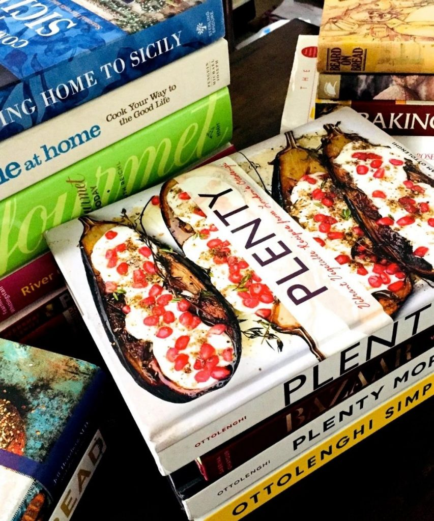 Sets of cookbooks stacked near each other